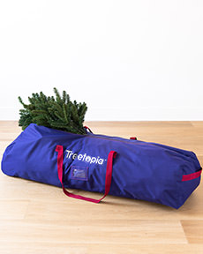 Keep your favorite tree safely tucked away for next season in our Roll with It Tree Storage Bag. Find more rolling Christmas tree storage bags at Treetopia.